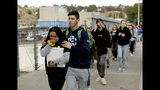Students are escorted out of Saugus High School after reports of a shooting on Thursday, Nov. 14, 2019, in Santa Clarita, Calif. (AP Photo/Marcio Jose Sanchez)
