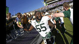 Baylor offensive lineman Xavier Newman (55) celebrates with fans following an NCAA college football game against TCU, Saturday, Nov. 9, 2019, in Fort Worth, Texas. Baylor won 29-23 in triple overtime. (AP Photo/Ron Jenkins)
