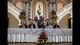 Bolivia's interim President Jeanine Anez, center, holds a press conference accompanied by Health Minister Anibal Cruz, from left, Economy Minister Jose Luis Parada, Communications Minister Roxana Lizarraga and Environment Minster Maria Elva Pinckert, in La Paz, Bolivia, Friday, Nov. 15, 2019. Anez, a Senate deputy leader who claimed the interim presidency, is moving to establish authority in the turbulent country. (AP Photo/Natacha Pisarenko)