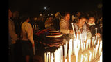 Mourners light candles around coffins of backers of former President Evo Morales that died during clashes with security forces in Sacaba, Bolivia, Friday, Nov. 15, 2019. Bolivian security forces clashed with Morales' backers leaving at least five people dead, dozens more injured and escalating the challenge to the country's interim government to restore stability. (AP Photo/Juan Karita)
