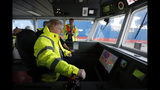 Britain's Prime Minister Boris Johnson steers a tug boat during a General Election campaign stop in the port of Bristol, England, Thursday, Nov. 14, 2019. Britain goes to the polls on Dec. 12. (AP Photo/Frank Augstein, Pool)