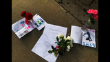 Flowers and notes have been left outside Saugus High School in Santa Clarita, Calif., late Thursday afternoon, Nov. 1, 2019, after a shooting incident there that morning. Authorities said a 16-year-old student shot five students, then himself. (AP Photo/Natalie Rice)