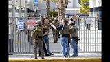 FBI and other law enforcement gather at the scene following a shooting at Saugus High School, Thursday, Nov. 14, 2015 in Santa Clarita, Calif. (Hans Gutknecht/The Orange County Register via AP)