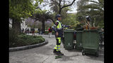 """In this Nov. 4, 2019 photo, retired Segundo Vergara, 69, works cleaning the Plaza de Armas in downtown Santiago, Chile. Vergara, who earns 400,000 pesos ($530) a month as a cleaner, said while attending a demonstration in Santiago that if his wife wasn't working, """"we would be living off bread and water, eating rice and pasta every day."""" (AP Photo/Esteban Felix)"""