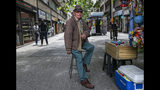 In this Nov. 4, 2019 photo, retired Emilio Monardes, 78, works as a street merchant in downtown Santiago, Chile. More than 1.2-million Chileans receive a pension that is less than $216 a month, well below the minimum salary of $400. Many retirees work in the informal sector to make ends meet. (AP Photo/Esteban Felix)