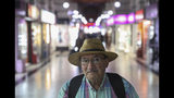 In this Nov. 5, 2019 photo, retired Nestor Osorio, 66, poses for a photo after a day of work in downtown Santiago, Chile. What started on Oct. 18 as a student protest over a modest subway fare hike has ballooned into a massive, mostly peaceful social uprising that continues to consume Chile. The protests include struggling retirees. (AP Photo/Esteban Felix)