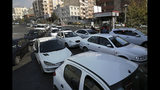 Vehicles queue to enter a gas station in Tehran, Iran, Friday, Nov. 15, 2019. Authorities have imposed rationing and increased the prices of fuel. The decision came following months of speculations about possible rationing after the U.S. in 2018 reimposed sanctions that sent Iran's economy into free-fall following Washington withdrawal from 2015 nuclear deal between Iran and world powers. (AP Photo/Vahid Salemi)