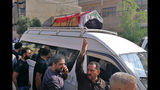 Mourners escort the flag-draped coffin of Mohammed Jassim, a protester killed in anti-government protests, during his funeral in Baghdad, Iraq, Friday, Nov. 15, 2019. Iraqi medical and security officials say one protester was killed and over 40 were wounded in renewed clashes overnight in central Baghdad. (AP Photo/Khalid Mohammed)