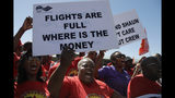 Members of the South African Cabin Crew Association and the National Union of Metalworkers of South Africa members picket at the SAA Airways Park in Kempton Park, South Africa, Friday, Nov. 15, 2019. South Africa's troubled state-owned airline has begun canceling flights after two unions announced their workers would go on strike to protest nearly 1,000 expected job cuts. (AP Photo/Themba Hadebe)