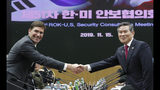 U.S. Defense Secretary Mark Esper, left, and South Korean Defense Minister Jeong Kyeong-doo shake hands for the media prior to the 51st Security Consultative Meeting (SCM) at Defense Ministry in Seoul, South Korea, Friday, Nov. 15, 2019. (AP Photo/Lee Jin-man, Pool)