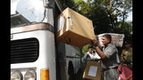 A Sri Lankan polling worker loads ballot papers and boxes onto a bus outside a material distribution center as they transport them to polling centers in Colombo, Sri Lanka, Friday, Nov. 15, 2019. Worries about Islamic extremism will be paramount for many Sri Lankan voters while others hope to block former leaders accused of human rights violations from returning to power in Saturday's presidential election, the country's first national polls since last Easter's deadly suicide attacks. (AP Photo/Eranga Jayawardena)