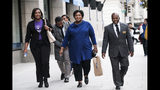 Former Georgia House Democratic Leader Stacey Abrams, center, departs from an event at the National Press Club, Friday, Nov. 15, 2019 in Washington. (AP Photo/Michael A. McCoy)