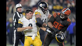 Cleveland Browns defensive end Myles Garrett (95) reacts after swinging a helmet at Pittsburgh Steelers quarterback Mason Rudolph (2) in the fourth quarter of an NFL football game, Thursday, Nov. 14, 2019, in Cleveland. The Browns won 21-7. (AP Photo/David Richard)