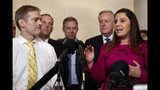 Rep. Jim Jordan, R-Ohio, left, listens as Rep. Elise Stefanik, R-N.Y., right, speaks to the media with other Republicans after former U.S. Ambassador to Ukraine Marie Yovanovitch testified to the House Intelligence Committee, Friday, Nov. 15, 2019, on Capitol Hill in Washington, in the second public impeachment hearing on President Donald Trump's efforts to tie U.S. aid for Ukraine to investigations of his political opponents. Left of Stefanik is Rep. Mark Meadows, R-N.C. (AP Photo/Jacquelyn Martin)