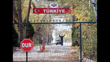 """An man who is identified by Turkish news reports as a U.S. citizen who has been deported by Turkey and is now stuck in the heavily militarized no-man's land between Greece and Turkey, after Greece refused to take him in, near Pazarkule border gate, Edirne, Turkey, Monday Nov. 11, 2019. Ankara began deporting captured foreign IS fighters, and asked to comment on the reports, Erdogan said: """"Whether they are stuck there at the border it doesn't concern us. We will continue to send them. Whether they take them or not, it is not our concern."""" (DHA via AP)"""