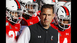 Cincinnati head coach Luke Fickell takes the field with his players before the first half of an NCAA college football game against Connecticut, Saturday, Nov. 9, 2019, in Cincinnati. (AP Photo/John Minchillo)