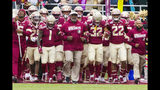 Florida State interim head coach Odell Haggins leads his team onto the field for an NCAA college football game against Alabama State in Tallahassee, Fla., Saturday, Nov. 16, 2019. (AP Photo/Mark Wallheiser)