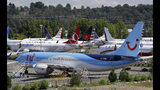 File-This Aug. 15, 2019, file photo shows dozens of grounded Boeing 737 MAX airplanes crowd a parking area adjacent to Boeing Field in Seattle. Boeing is settling more of the roughly 150 lawsuits filed by families of passengers killed in two crashes of the 737 Max jet. A Seattle law firm said Friday, Nov. 15, 2019, it settled four cases involving passengers on the Lion Air Max that crashed off the coast of Indonesia in October 2018. On Thursday, a judge approved settlements of nine other cases.(AP Photo/Elaine Thompson, File)