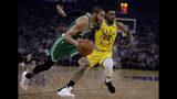 Boston Celtics' Jayson Tatum, left, drives the ball against Golden State Warriors' Glenn Robinson III (22) in the first half of an NBA basketball game Friday, Nov. 15, 2019, in San Francisco. (AP Photo/Ben Margot)