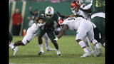 South Florida's Trevon Sands is tackled by Cincinnati's Elijah Ponder during the first half of an NCAA college football game, Saturday, Nov. 16, 2019, in Tampa, Fla. (AP Photo/Mike Carlson)