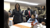 Democratic presidential candidate Sen. Kamala Harris, D-Calif., speaks to Aaron Nachampassak, 11, right and others at a church congregation breakfast in Fort Dodge, Iowa, on Nov. 10, 2019. Harris is campaigning regularly in Iowa as she seeks to boost her struggling campaign. (AP Photo/Kathleen Ronayne)