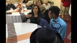 Democratic presidential candidate Sen. Kamala Harris, D-Calif., speaks to DeVon Walker, 17, right, at a church congregation breakfast in Fort Dodge, Iowa, on Nov. 10, 2019. (AP Photo/Kathleen Ronayne)