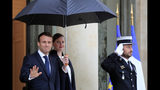 French President Emmanuel Macron gestures as he waits for EU Council President-elect Charles Michel at the Elysee Palace Friday, Nov. 15, 2019 in Paris. (AP Photo/Michel Euler)