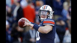 Auburn quarterback Bo Nix (10) warms up before an NCAA college football game against Georgia, Saturday, Nov. 16, 2019, in Auburn, Ala. (AP Photo/Butch Dill)