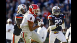 Georgia wide receiver Dominick Blaylock (8) catches a pass for a touchdown as Auburn defensive back Christian Tutt (6) defends during the first half of an NCAA college football game, Saturday, Nov. 16, 2019, in Auburn, Ala. (AP Photo/Butch Dill)