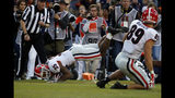 Georgia running back Brian Herrien (35) dives into the end zone for a touchdown during the first half of an NCAA college football game against Auburn, Saturday, Nov. 16, 2019, in Auburn, Ala. (AP Photo/Butch Dill)