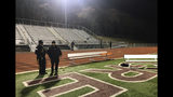 Police investigate the scene after a gunman shot into a crowd of people during a football game at Pleasantville High School in Pleasantville, N.J., Friday, Nov. 15, 2019. Players and spectators ran for cover Friday night when a gunman opened fire at the New Jersey high school football game. (Ahmad Austin/The Press of Atlantic City via AP)