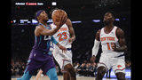 Charlotte Hornets' Devonte' Graham (4) drives past New York Knicks' Mitchell Robinson (23) and New York Knicks' Bobby Portis (1) during the first half of an NBA basketball game, Saturday, Nov. 16, 2019, in New York. (AP Photo/Frank Franklin II)