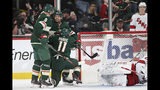 Minnesota Wild's Zach Parise (11) celebrates with teammates Matt Dumba (24) and Mikko Koivu (9) after Parise scored a goal against the Carolina Hurricanes in the second period of an NHL hockey game Saturday, Nov. 16, 2019, in St. Paul, Minn. (AP Photo/Stacy Bengs)