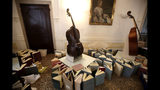 Music books are placed to dry at the first floor of Venice Conservatory after being recovered from ground floor, Italy, Saturday, Nov. 16, 2019. High tidal waters returned to Venice on Saturday, four days after the city experienced its worst flooding in 50 years. Young Venetians are responding to the worst flood in their lifetimes by volunteering to help salvage manuscripts, clear out waterlogged books and lend a hand where needed throughout the stricken city.(AP Photo/Luca Bruno)
