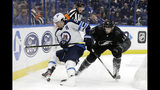 Winnipeg Jets center Mark Scheifele (55) moves the puck around Tampa Bay Lightning center Cedric Paquette (13) during the first period of an NHL hockey game Saturday, Nov. 16, 2019, in Tampa, Fla. (AP Photo/Chris O'Meara)