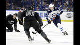 Winnipeg Jets right wing Patrik Laine (29) moves the puck around Tampa Bay Lightning center Yanni Gourde (37) and defenseman Erik Cernak (81) during the first period of an NHL hockey game Saturday, Nov. 16, 2019, in Tampa, Fla. (AP Photo/Chris O'Meara)