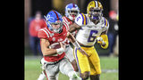 Mississippi quarterback John Rhys Plumlee (10) runs past LSU linebacker Jacob Phillips (6) to score in the third quarter during an NCAA college football game Saturday, Nov. 16, 2019, in Oxford, Miss. (Bruce Newman/Oxford Eagle via AP)
