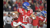 Mississippi quarterback John Rhys Plumlee (10) looks for a receiver during the first half of the team's NCAA college football game against LSU in Oxford, Miss., Saturday, Nov. 16, 2019. (AP Photo/Thomas Graning)