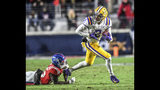 LSU wide receiver Justin Jefferson (2) eludes Mississippi defensive back Jalen Julius (26) during an NCAA college football game Saturday, Nov. 16, 2019, in Oxford, Miss. (Bruce Newman/Oxford Eagle via AP)