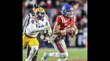 Mississippi quarterback John Rhys Plumlee (10) looks for a receiver as LSU's K'Lavon Chasson gives chase during an NCAA college football game Saturday, Nov. 16, 2019, in Oxford, Miss. (Bruce Newman/Oxford Eagle via AP)