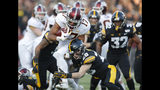 Minnesota wide receiver Seth Green (17), left, runs the ball as he is tackled by Iowa defensive back Jack Koerner during the first half of an NCAA college football game, Saturday, Nov. 16, 2019, in Iowa City, Iowa. (AP Photo/Matthew Putney)