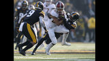 Minnesota wide receiver Demetrius Douglas, center, runs the ball as he is chased down by Iowa defensive back Terry Roberts as Iowa defensive back Geno Stone, left, comes in to assist during the first half of an NCAA college football game, Saturday, Nov. 16, 2019, in Iowa City, Iowa. (AP Photo/Matthew Putney)