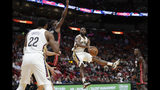 New Orleans Pelicans guard E'Twaun Moore, right, looks to pass as Miami Heat center Bam Adebayo, right, defends during the first half of an NBA basketball game, Saturday, Nov. 16, 2019, in Miami. (AP Photo/Lynne Sladky)