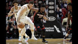 Miami Heat forward Chris Silva (30) loses control of the ball as New Orleans Pelicans forward Nicolo Melli recovers the ball during the first half of an NBA basketball game, Saturday, Nov. 16, 2019, in Miami. (AP Photo/Lynne Sladky)