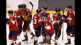 Florida Panthers players celebrate their win over the New York Rangers in an NHL hockey game, Saturday, Nov. 16, 2019, in Sunrise, Fla. (AP Photo/Joe Skipper)