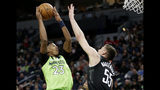 Minnesota Timberwolves guard Jarrett Culver (23) shoots on Houston Rockets center Isaiah Hartenstein (55) in the first quarter during an NBA basketball game Saturday, Nov. 16, 2019 in Minneapolis. (AP Photo/Andy Clayton- King)