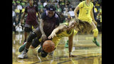 Texas Southern's Ataiya Bridges, center left, battles Oregon's Sabrina Ionescu for the ball during the first quarter of an NCAA college basketball game in Eugene, Ore., Saturday, Nov. 16, 2019. (AP Photo/Chris Pietsch)