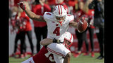Wisconsin wide receiver A.J. Taylor (4) extends the ball over the goal line for a touchdown against Nebraska safety Marquel Dismuke (19) during the first half of an NCAA college football game in Lincoln, Neb., Saturday, Nov. 16, 2019. (AP Photo/Nati Harnik)