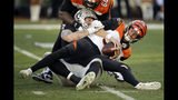 Cincinnati Bengals quarterback Ryan Finley, front, is sacked by Oakland Raiders defensive end Maxx Crosby during the second half of an NFL football game in Oakland, Calif., Sunday, Nov. 17, 2019. (AP Photo/Ben Margot)