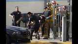Emergency personnel remove an injured person following a shooting at Saugus High School, Thursday, Nov. 14, 2015 in Santa Clarita, Calif. (David Crane/The Orange County Register via AP)